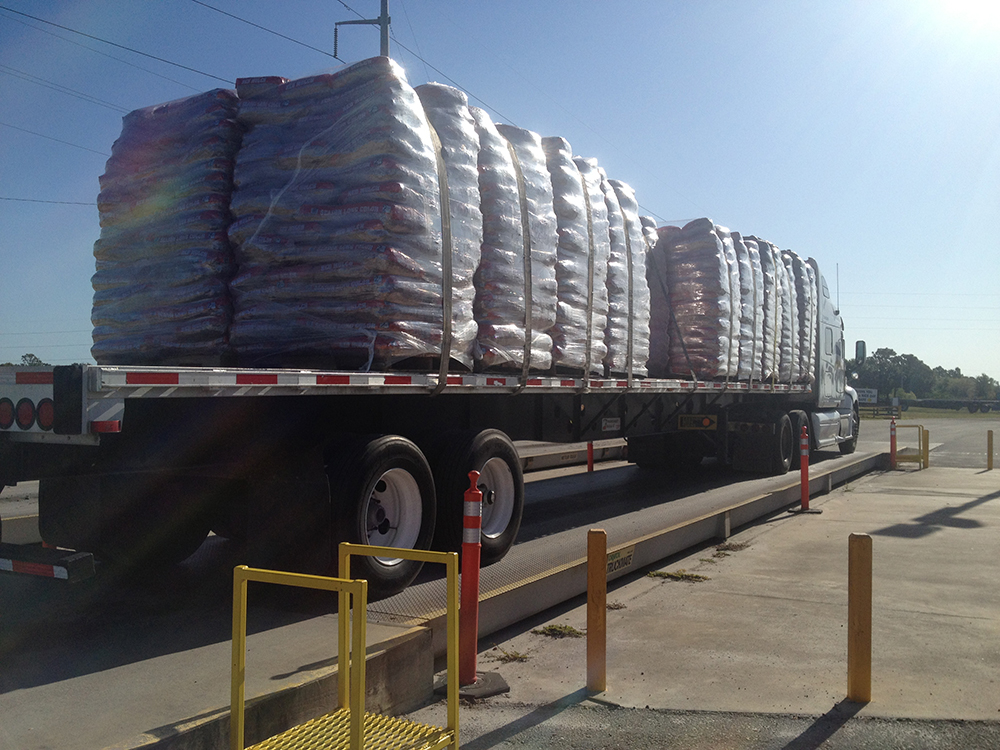 many bags of mulch loaded onto an 18 wheeler