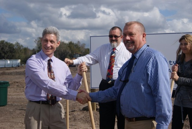 People shaking hands at Hardee County Commerce Park groundbreaking ceremony
